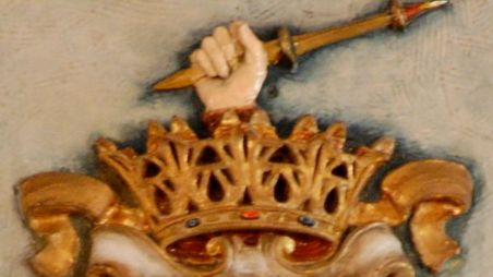 Ducal crown with hand